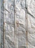 Fondo oxidado abollado del estaño del granero Fotos de archivo