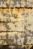 Fondo oxidado de la vendimia del primer de la pared de la casa del estaño Foto de archivo libre de regalías