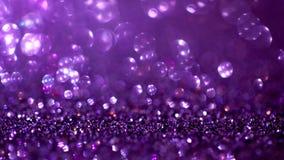 Fondo púrpura de la magia del brillo Luz Defocused y lugar enfocado libre para su diseño fotos de archivo libres de regalías