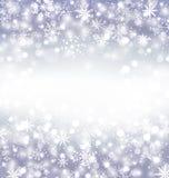 Fondo púrpura de Navidad con los copos de nieve y espacio de la copia para usted Imagen de archivo libre de regalías