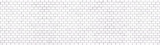 Fondo panorámico de la pared de ladrillo blanca para el diseño imagen de archivo libre de regalías