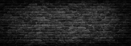 Fondo panorámico de la pared de ladrillo negra para el diseño Imágenes de archivo libres de regalías