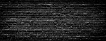 Fondo panorámico de la pared de ladrillo negra Fotografía de archivo