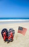 Fondo patriótico de los E.E.U.U. en la playa arenosa Foto de archivo
