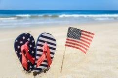 Fondo patriótico de los E.E.U.U. en la playa arenosa Foto de archivo libre de regalías