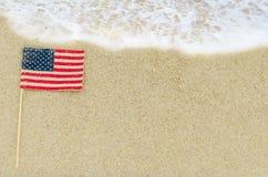 Fondo patriótico de los E.E.U.U. en la playa arenosa Imagenes de archivo