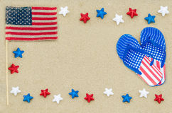 Fondo patriótico de los E.E.U.U. en la playa arenosa Imágenes de archivo libres de regalías