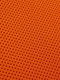 Fondo perforato arancio del modello di struttura del tessuto Immagini Stock Libere da Diritti