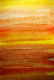 Fondo pintado a mano anaranjado de la acuarela imagenes de archivo