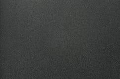 Fondo plástico granoso negro fotos de archivo
