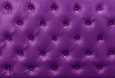 Fondo púrpura del cuero del sofá Foto de archivo libre de regalías