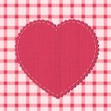 Fondo a quadretti con l'etichetta del cuore Fotografie Stock Libere da Diritti