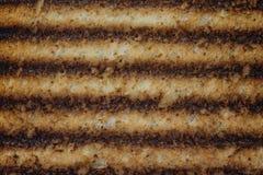 Fondo quemado de la tostada Imagenes de archivo