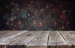 Fondo rústico de los tableros de madera y de las luces del bokeh aliste para la exhibición del producto fotos de archivo