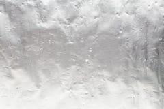 Fondo rasguñado brillante de la hoja de la textura del metal plateado foto de archivo libre de regalías