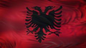 Fondo realista de la bandera de ALBANIA que agita Foto de archivo
