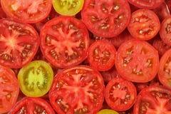 Fondo rebanado de los tomates Foto de archivo libre de regalías