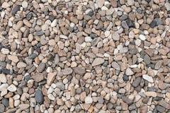 Fondo redondeado del extracto de la textura de los grados de las piedras de las rocas fotos de archivo