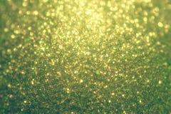 Fondo retro de la Navidad del brillo, textura brillante, fondo de la chispa del oro Colores del vintage Imagen de archivo libre de regalías