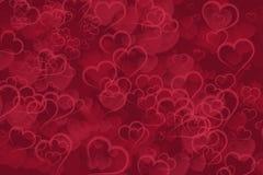 Fondo rojo abstracto del bokeh de los corazones Imagen de archivo libre de regalías