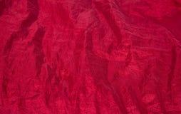 Fondo rojo brillante del tafetán de la tela Foto de archivo libre de regalías