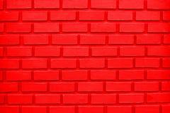 Fondo rojo colorido de la pared de ladrillo O fondo rojo colorido de la pared de ladrillo foto de archivo