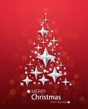 Fondo rojo con el árbol de navidad bajo la forma de estrellas Imágenes de archivo libres de regalías
