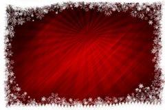 Fondo rojo con los copos de nieve Imágenes de archivo libres de regalías