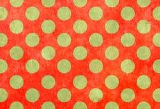 Fondo rojo con los puntos verdes fotografía de archivo