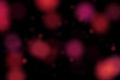 Fondo rojo de la chispa de la Navidad con el bokeh, Feliz Año Nuevo del día de fiesta de Navidad Fotos de archivo libres de regalías