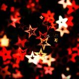Fondo rojo de la estrella que brilla intensamente Fotos de archivo libres de regalías