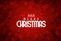 Fondo rojo de la Feliz Navidad con las escamas de la nieve foto de archivo libre de regalías