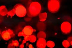 Fondo rojo de la luz del bokeh Fotografía de archivo