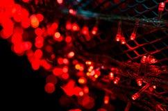 Fondo rojo de la luz del bokeh Fotos de archivo libres de regalías