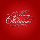 Fondo rojo de la Navidad con lette caligráfico de la Feliz Navidad Foto de archivo