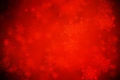 Fondo rojo de la Navidad con los copos de nieve Fotos de archivo