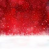 Fondo rojo de la Navidad con los copos de nieve y las estrellas Foto de archivo