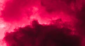 Fondo rojo de la nube Foto de archivo