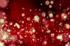 Fondo rojo de la pendiente abstracta de la Navidad con el bokeh que fluye, Feliz Año Nuevo del día de fiesta festivo Foto de archivo