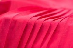 Fondo rojo de la tela del plisado imagen de archivo libre de regalías