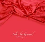 Fondo rojo de tela de seda Fotografía de archivo