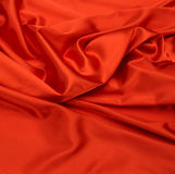 Fondo rojo de tela de seda Foto de archivo libre de regalías