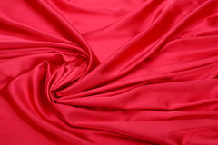 Fondo rojo de tela de seda Imágenes de archivo libres de regalías