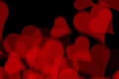 Fondo rojo del amor de los corazones Fotos de archivo libres de regalías