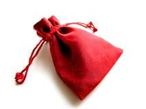 Fondo rojo del blanco de la bolsita Imagen de archivo