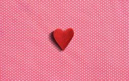 Fondo rojo del modelo del corazón de la tela Imagen de archivo libre de regalías