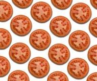 Fondo rojo del modelo del tomate, rebanadas de tomate en el fondo blanco Fotos de archivo
