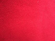 Fondo rojo del paño grueso y suave fotos de archivo