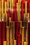 Fondo rojo del plástico del metal del oro Imagen de archivo