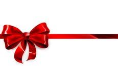 Fondo rojo del regalo del arco Imagen de archivo libre de regalías